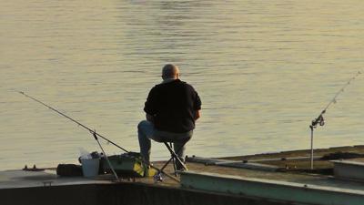 Fischer mit Angelruten